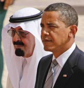 King Abdullah of Saudi Arabia welcomes President Barack Obama upon his arrival in Riyadh, Wednesday, June 3, 2009. (AP Photo/Hassan Ammar)